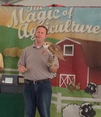 Jason Caldwell holds a Barn Owl.